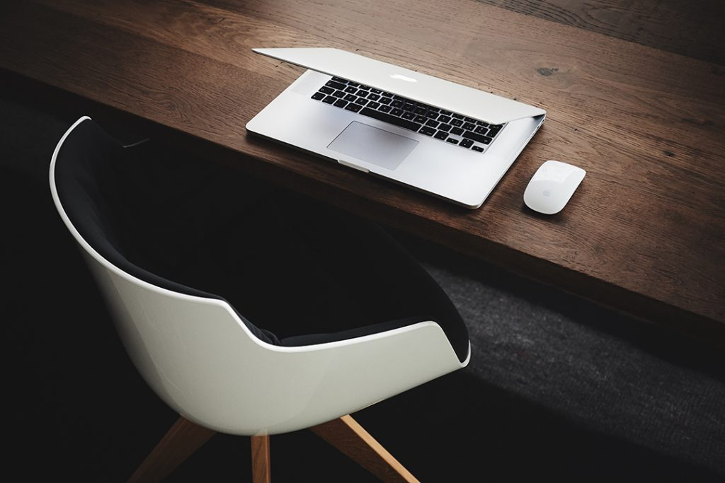 chair and mac laptop for writing
